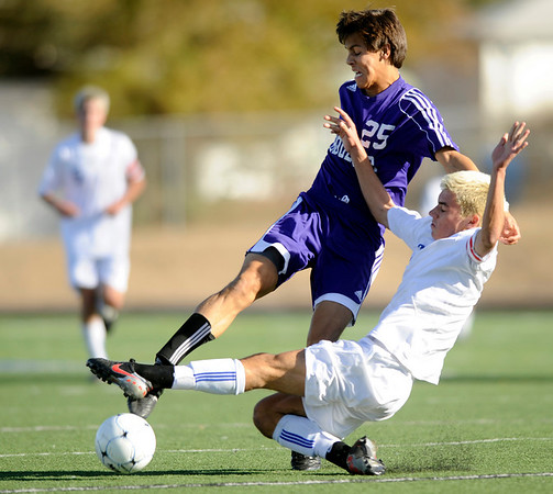 """Boulder High School senior Beau Salgado and Cherry Creek senior Tom Jaeger fight for the ball during the Class 5A State soccer semifinals against Cherry Creek on Saturday, Nov. 6, at Englewood High School. Cherry Creek defeated Boulder 2-1.<br /> For more photos go to  <a href=""""http://www.dailycamera.com"""">http://www.dailycamera.com</a><br /> Photo by JEREMY PAPASSO"""