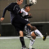 Boulder High School senior Enrique Womack fights for the ball with Columbine senior Peter Schechtel on Thursday, Oct. 28, during a soccer game at Recht Field. Boulder High defeated Columbine 2-0.<br /> Jeremy Papasso/ Camera