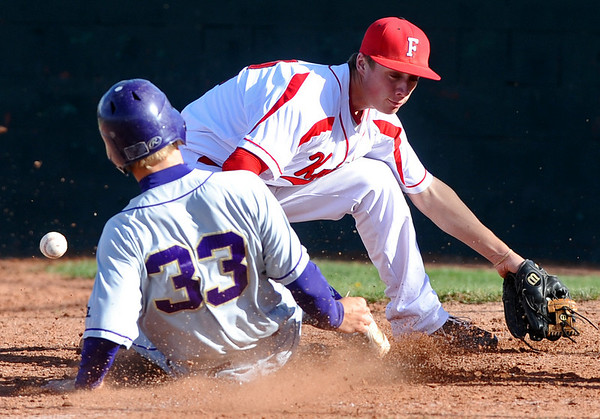BVSFV<br /> Fairview pitcher Jake Olsen fails to tag out Luke Bukowski of Boulder at home plate.<br /> Photo by Marty Caivano/April 25, 2011