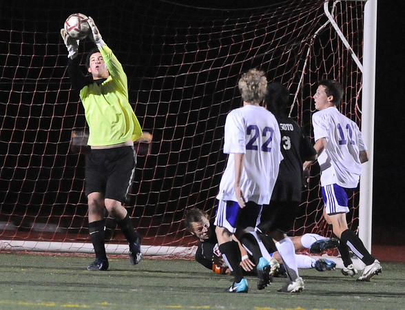 BHFV<br /> Boulder goalkeeper Murray Smith snags a goal attempt against Fairview.<br /> Photo by Marty Caivano/Camera/Oct. 5, 2010