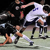 BHFV<br /> Boulder's Brooks DiPaula trips over Soren Frykholm of Fairview.<br /> Photo by Marty Caivano/Camera/Oct. 5, 2010