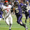"Boulder High School's Demetrius Kennedy rushes past Jonathan Swartzwelter for big yardage during a game against Fairview High School on Friday, Oct. 26, at Recht Field in Boulder. Fairview won the game. For more photos of the game go to  <a href=""http://www.dailycamera.com"">http://www.dailycamera.com</a><br /> Jeremy Papasso/ Camera"