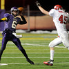 "Boulder High School quarterback T.J. Patterson passes the ball in front of Ian Von Rock during a game against Fairview High School on Friday, Oct. 26, at Recht Field in Boulder. Fairview won the game. For more photos of the game go to  <a href=""http://www.dailycamera.com"">http://www.dailycamera.com</a><br /> Jeremy Papasso/ Camera"