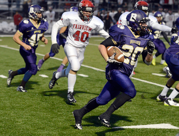 "Boulder High School's Alex Ybarra runs the ball during a game against Boulder High School on Friday, Oct. 26, at Recht Field in Boulder. Fairview won the game. For more photos of the game go to  <a href=""http://www.dailycamera.com"">http://www.dailycamera.com</a><br /> Jeremy Papasso/ Camera"