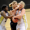 "Ashley Kennedy, left, and Ande Lampert, both of Boulder High, battle with Georgina Ryder of Fairview.<br /> For more photos of the game, go to  <a href=""http://www.dailycamera.com"">http://www.dailycamera.com</a>.<br /> Cliff Grassmick / February 18, 2011"