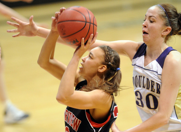 "Carlee Lough of Fairview, shoots around Lizzie Hickey of Boulder High.<br /> For more photos of the game, go to  <a href=""http://www.dailycamera.com"">http://www.dailycamera.com</a>.<br /> Cliff Grassmick / February 18, 2011"