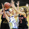 "Amy Coates, left, of Boulder, and Carlee Lough of Fairview, battle for a rebound Friday night.<br /> For more photos of the game, go to  <a href=""http://www.dailycamera.com"">http://www.dailycamera.com</a>.<br /> Cliff Grassmick / February 18, 2011"