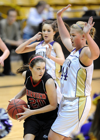 "Caitlin Higgins of Fairview, looks for room against Ande Lampert of Boulder High.<br /> For more photos of the game, go to  <a href=""http://www.dailycamera.com"">http://www.dailycamera.com</a>.<br /> Cliff Grassmick / February 18, 2011"