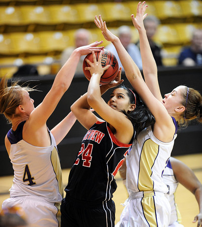 "Sonia Ghosh, center, of Fairview, goes up to shoot between Emilie Burns, left, and Lizzie Hickey, both of Boulder High.<br /> For more photos of the game, go to  <a href=""http://www.dailycamera.com"">http://www.dailycamera.com</a>.<br /> Cliff Grassmick / February 18, 2011"