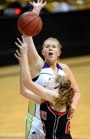"Ande Lampert of Boulder High, goes up to block the shot of Hannah Hyde of Fairview.<br /> For more photos of the game, go to  <a href=""http://www.dailycamera.com"">http://www.dailycamera.com</a>.<br /> Cliff Grassmick / February 18, 2011"