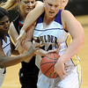 "Georgina Ryder, left,  of Fairview, and Ande Lampert of Boulder High, try to get control of the ball.<br /> For more photos of the game, go to  <a href=""http://www.dailycamera.com"">http://www.dailycamera.com</a>.<br /> Cliff Grassmick / February 18, 2011"