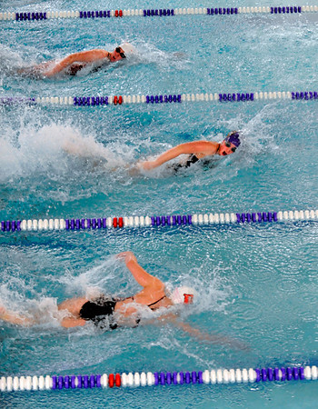 """Boulder High School senior Siobhan Hengemuhle, middle, tries to hold her lead while racing in the 50 Yard Freestyle on Thursday, Jan. 6, during a swim meet against Fairview High School at the North Boulder Recreation Center pool in Boulder. Hengemuhle won the race. For more photos go to  <a href=""""http://www.dailycamera.com"""">http://www.dailycamera.com</a><br /> Jeremy Papasso/ Camera"""