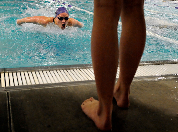 """Boulder High School junior Jennifer Harrison speeds through the water in the girls 100 Yard Butterfly race on Thursday, Jan. 6, during a swim meet against Fairview High School at the North Boulder Recreation Center pool in Boulder. Harrison took first place in the race. For more photos go to  <a href=""""http://www.dailycamera.com"""">http://www.dailycamera.com</a><br /> Jeremy Papasso/ Camera"""