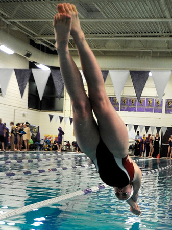 """Fairview High School's Lacey Smith dives into the water at the start of the 100-yard freestyle race during a swim meet against Boulder High School on Thursday, Jan. 17, at the North Boulder Recreation Center. For more photos of the meet go to  <a href=""""http://www.dailycamera.com"""">http://www.dailycamera.com</a><br /> Jeremy Papasso/ Camera"""