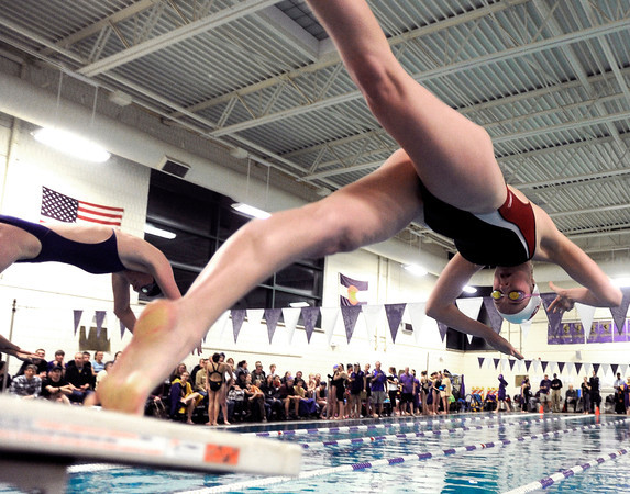 "Fairview High School's Lacey Smith dives into the water at the start of the 100-yard freestyle race during a swim meet against Boulder High School on Thursday, Jan. 17, at the North Boulder Recreation Center. Smith won the race. For more photos of the meet go to  <a href=""http://www.dailycamera.com"">http://www.dailycamera.com</a><br /> Jeremy Papasso/ Camera"