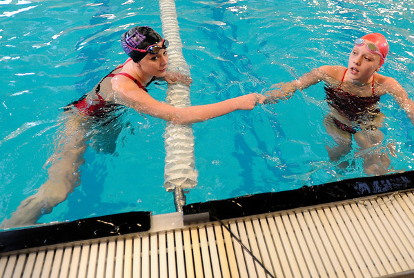 "Boulder High School's Haley Rowley, left, shakes hands with Fairview's Sandra Freeman during the 200-yard IM in a swim meet against Fairview High School on Thursday, Jan. 17, at the North Boulder Recreation Center. Rowley won the race. For more photos of the meet go to  <a href=""http://www.dailycamera.com"">http://www.dailycamera.com</a><br /> Jeremy Papasso/ Camera"