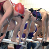 "Boulder High School's Haley Rowley, center, gets in the ready position at the start of the 200-yard IM during a swim meet against Fairview High School on Thursday, Jan. 17, at the North Boulder Recreation Center. Rowley won the race. For more photos of the meet go to  <a href=""http://www.dailycamera.com"">http://www.dailycamera.com</a><br /> Jeremy Papasso/ Camera"