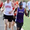 TRACK<br /> Boulder's Ashi Guiles leads the 1600 in lap three, followed closely by Lewis Commons and John Coats of Fairview. Guiles went on to win the race, with Coats second and Commons third. <br /> Photo by Marty Caivano/Camera/March 17, 2010