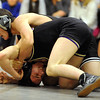 WRESTLE<br /> Fairview's Ben Bulow, top, works to pin Garth Goodrich of Boulder in the 145-pound class.<br /> Photo by Marty Caivano/Camera/Dec. 9, 2010