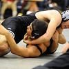 WRESTLE<br /> Fairview's Andrew Bedell, top, wrestles Jacobo Jimenez of Boulder in the 152-pound class.<br /> Photo by Marty Caivano/Camera/Dec. 9, 2010