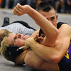WRESTLE<br /> Boulder's John Stork, left, struggles to break the hold of John Sims of Fairview in the 160-pound class.<br /> Photo by Marty Caivano/Camera/Dec. 9, 2010