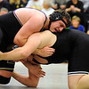 WRESTLE<br /> Boulder's Hans Lehndorff, top, wrestles Connor McGraw of Fairview in the 285-pound class.<br /> Photo by Marty Caivano/Camera/Dec. 9, 2010
