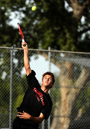 "Fairview High School's Johnny Combs serves the ball on Thursday, Sept. 22, during a tennis match against Boulder's Julian Melcer at Centennial Middle School in Boulder. For more photos of the matches go to  <a href=""http://www.dailycamera.com"">http://www.dailycamera.com</a><br /> Jeremy Papasso/ Camera"