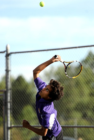 "Boulder High School's Jaron Belcher serves the ball on Thursday, Sept. 22, during the #1 singles match against Eli Winegardner, of Fairview, at Centennial Middle School in Boulder. For more photos of the matches go to  <a href=""http://www.dailycamera.com"">http://www.dailycamera.com</a><br /> Jeremy Papasso/ Camera"