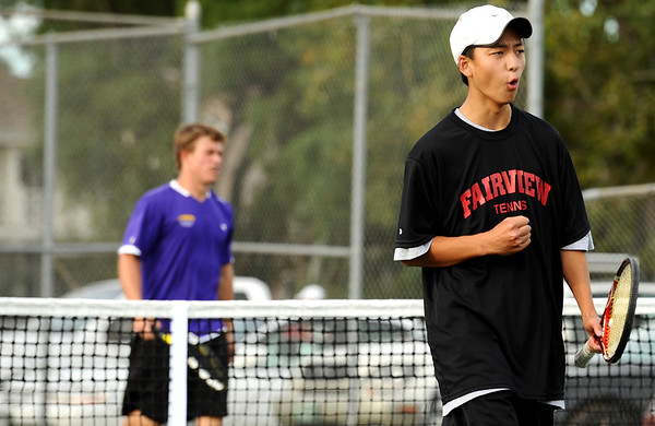 "Fairview High School's Kevin Chen, right, shows his emotions after defeating Boulder High School in the #1 doubles tennis match on Thursday, Sept. 22, at Centennial Middle School in Boulder. For more photos of the matches go to  <a href=""http://www.dailycamera.com"">http://www.dailycamera.com</a><br /> Jeremy Papasso/ Camera"