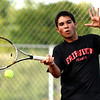 "Fairview High School's Eli Winegardner returns the ball on Thursday, Sept. 22, during the #1 singles match against Jaron Belcher, of Boulder High School, at Centennial Middle School in Boulder. For more photos of the matches go to  <a href=""http://www.dailycamera.com"">http://www.dailycamera.com</a><br /> Jeremy Papasso/ Camera"