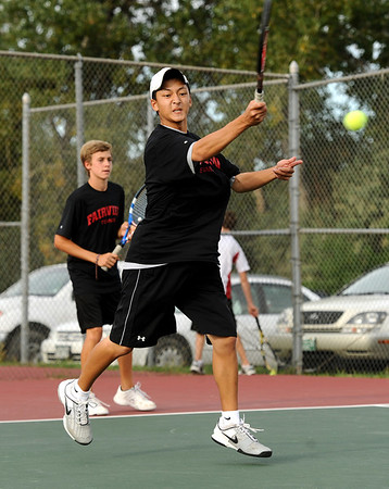 """Fairview High School's Kevin Chen returns the ball on Thursday, Sept. 22, during the #1 doubles tennis match against Boulder High School at Centennial Middle School in Boulder. For more photos of the matches go to  <a href=""""http://www.dailycamera.com"""">http://www.dailycamera.com</a><br /> Jeremy Papasso/ Camera"""