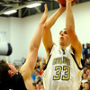 """Boulder High School senior Eric Rothweiller shoots a two-pointer over Fossil Ridge's Chris Hansen during a basketball game on Thursday, Jan. 27, at Boulder High School. Boulder defeated Fossil Ridge 54-51. Go to  <a href=""""http://www.dailycamera.com"""">http://www.dailycamera.com</a> for a photo gallery of the game.<br /> Jeremy Papasso/ Camera"""