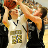 """Boulder High School senior Riley Grabau drives the ball past Fossil Ridge's Alec Quaid during a basketball game on Thursday, Jan. 27, at Boulder High School. Boulder defeated Fossil Ridge 54-51. Go to  <a href=""""http://www.dailycamera.com"""">http://www.dailycamera.com</a> for a photo gallery of the game.<br /> Jeremy Papasso/ Camera"""