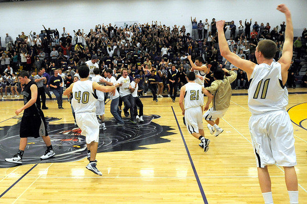 """Boulder High School senior Eric Rothweiller, right, celebrates with his team after winning the basketball game against Fossil Ridge on Thursday, Jan. 27, at Boulder High School. Boulder defeated Fossil Ridge 54-51. Go to  <a href=""""http://www.dailycamera.com"""">http://www.dailycamera.com</a> for a photo gallery of the game.<br /> Jeremy Papasso/ Camera"""