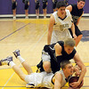 """Boulder High School senior Eric Rothweiller fights with Fossil Ridge defenders to recover the ball during a basketball game on Thursday, Jan. 27, at Boulder High School. Boulder defeated Fossil Ridge 54-51. Go to  <a href=""""http://www.dailycamera.com"""">http://www.dailycamera.com</a> for a photo gallery of the game.<br /> Jeremy Papasso/ Camera"""
