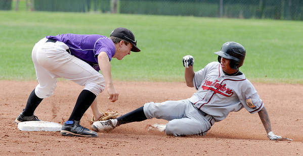 "Levi Chandler, left, of Boulder, gets the out on Marcus Wirth of Gene Taylor's Baseball.<br /> For  more photos of the game, go to  <a href=""http://www.dailycamera.com"">http://www.dailycamera.com</a>.<br /> Cliff Grassmick  / August 2, 2012"