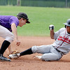 """Levi Chandler, left, of Boulder, gets the out on Marcus Wirth of Gene Taylor's Baseball.<br /> For  more photos of the game, go to  <a href=""""http://www.dailycamera.com"""">http://www.dailycamera.com</a>.<br /> Cliff Grassmick  / August 2, 2012"""