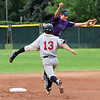 """Levi Chandler of Boulder gets to the ball and gets the out at second on  Cole Cummins of Gene Taylor's Baseball.<br /> For  more photos of the game, go to  <a href=""""http://www.dailycamera.com"""">http://www.dailycamera.com</a>.<br /> Cliff Grassmick  / August 2, 2012"""