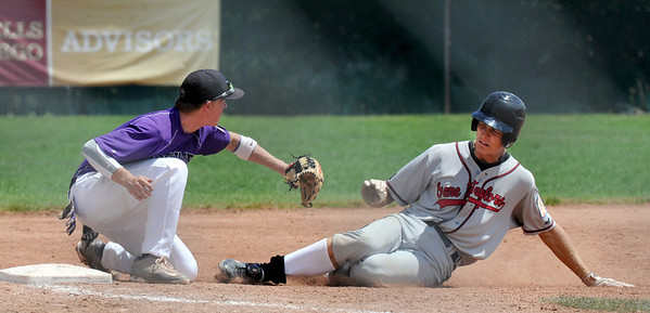 "Tommy Baumgartner of Boulder gets Drew Bridges of Gene Taylor's Baseball out at third.<br /> For  more photos of the game, go to  <a href=""http://www.dailycamera.com"">http://www.dailycamera.com</a>.<br /> Cliff Grassmick  / August 2, 2012"