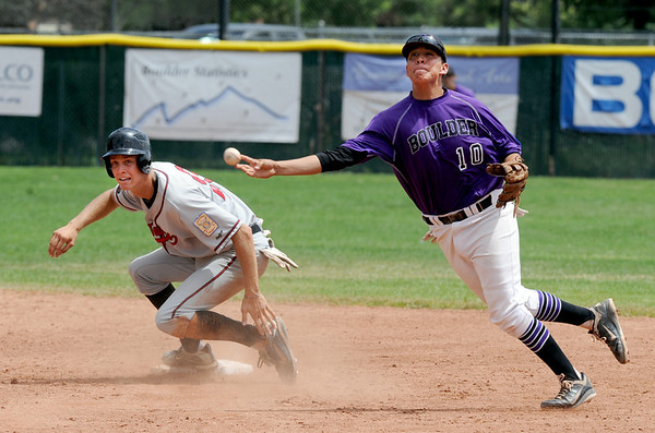 "Reuben Garcia of Boulder turns the double play on Drew Bridges of Gene Taylor's Baseball.<br /> For  more photos of the game, go to  <a href=""http://www.dailycamera.com"">http://www.dailycamera.com</a>.<br /> Cliff Grassmick  / August 2, 2012"