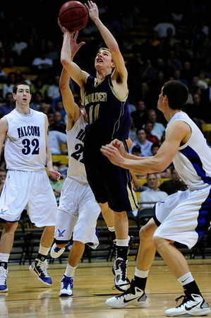 BLDRHR<br /> Boulder's Eric Rothweiller gets a shot against Highland Ranch in the final quarter.<br /> Photo by Marty Caivano/March 10, 2011