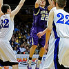 BLDRHR<br /> Boulder's Riley Grabau shoots over Marcus Byrd, left, and Austin Haldorson of Highlands Ranch.<br /> Photo by Marty Caivano/March 10, 2011