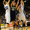 BLDRHR<br /> Boulder's Chris Zeren gets off a shot while pressured by Austin Haldorson, left and Marcus Byrd of Highlands Ranch.<br /> Photo by Marty Caivano/March 10, 2011