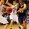 BLDRHR<br /> Boulder's Andre Rieder fires pass while under pressure from Austin Haldorson, left, and Steve Donatell of Highlands Ranch.<br /> Photo by Marty Caivano/March 10, 2011