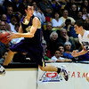 BLDRHR<br /> Boulder's Andre Rieder keeps a loose ball inbounds ahead of Steve Donatell of Highlands Ranch. Rieder passed the ball to Riley Grabau, who sank a three-pointer to take the lead in the fourth quarter.<br /> Photo by Marty Caivano/March 10, 2011