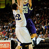BLDRHR<br /> Boulder's Zach Wilson shoots over Marcus Byrd of Highlands Ranch.<br /> Photo by Marty Caivano/March 10, 2011