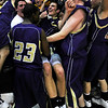 BLDRHR<br /> Members of the Boulder High School basketball team fall into the arms of their fans after winning the state championship semifinal against Highlands Ranch. They go on to play Regis Jesuit on Saturday. <br /> Photo by Marty Caivano/March 10, 2011