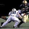 Boulder High School's Jordan Sloat (43) evades tackle by Legacy High School's Jake Levin (11) and Zach Wilson (28) during the game at Recht Field in Boulder, Thursday, Oct. 1, 2009.<br />  DAILY CAMERA/ KASIA BROUSSALIAN
