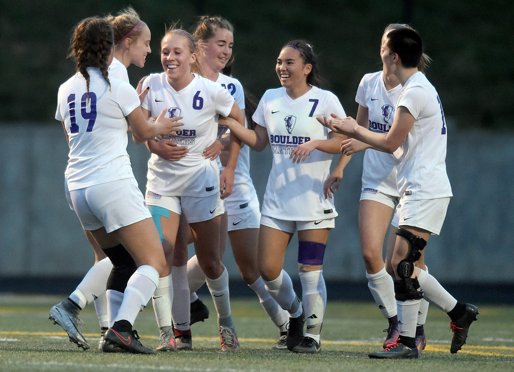 . Boulder High School\'s Alia Mentzell, center, is congratulated on a goal during a game against Legacy on Thursday at Recht Field in Boulder. More photo: BoCoPreps.com Jeremy Papasso/ Staff Photographer 04/12/2018