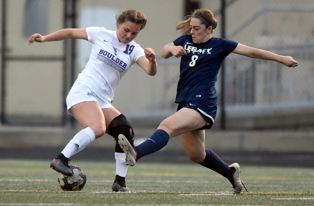 . Boulder High School\'s Shaiyah Weissman fights for the ball with Analisa Carmosino during a game against Legacy on Thursday at Recht Field in Boulder. More photo: BoCoPreps.com Jeremy Papasso/ Staff Photographer 04/12/2018